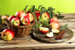 Beautiful apples on brown wooden background Royalty Free Stock Photos