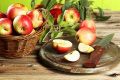 Beautiful apples on brown wooden background. Stock Images