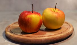 A beautiful apples. A beautiful fruit juicy red and yellow apple on a wooden board Royalty Free Stock Photos