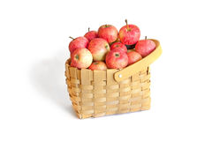 Beautiful apples in wicker basket on white. Beautiful tasty apples in wicker basket  on white background Royalty Free Stock Photos