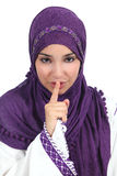 Beautiful arab woman asking for silence with the finger on lips. Isolated on a white background Stock Images