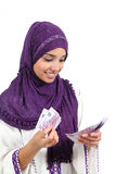Beautiful arab woman counting a lot of five hundred euros banknotes Royalty Free Stock Photography