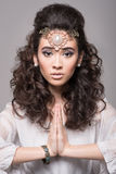Beautiful arab woman with curly hair wearing jewelery Stock Images