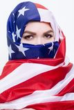 Beautiful Sirian woman wearing a hijab from the American flag. Beautiful Arab woman wearing a hijab from the American flag Stock Photo