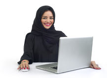 Beautiful Arabian business woman working on her laptop Stock Photography