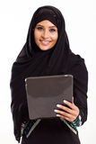 Arabian girl tablet. Beautiful Arabian girl with tablet computer isolated on white Royalty Free Stock Images