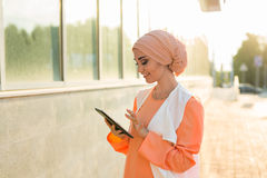Beautiful arabian girl with tablet computer. Muslim woman. Royalty Free Stock Images