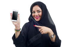 Beautiful Arabian model holding a cell phone on an isolated background Stock Image
