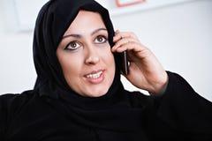 Beautiful Arabic woman on the phone. Beautiful Arabic woman enjoying a conversation on the phone Stock Photo