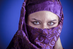 Beautiful arabic woman with traditional veil on her face, intens Stock Photography