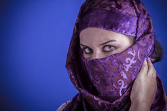 Beautiful arabic woman with traditional veil on her face, intens Stock Image