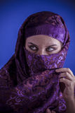 Beautiful arabic woman with traditional veil on her face, intens Royalty Free Stock Photos