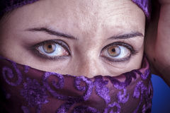 Beautiful arabic woman with traditional veil on her face, intens Royalty Free Stock Image