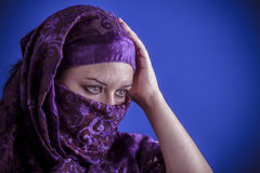 Beautiful arabic woman with traditional veil on her face, intens Stock Images