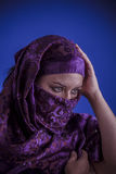 Beautiful arabic woman with traditional veil on her face, intens Royalty Free Stock Photo