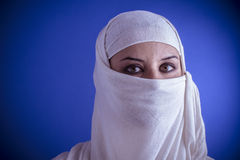 Beautiful arabic woman with traditional veil on her face, intens Stock Photo