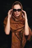 Beautiful arabic woman wearing sunglasses. Beautiful arabic caucasian woman wearing sunglasses. Dark background Stock Image
