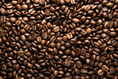 Fresh roasted arabica coffee beans background. Beautiful arabica coffee beans has very strong smell and excellent taste!Every coffee bean is unique Royalty Free Stock Image