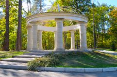 Beautiful arbor in autumn park. Beautiful gazebo in autumn park Stock Images