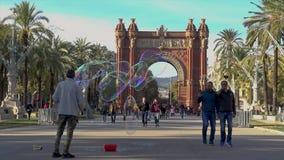 Beautiful arc in Bracelona of Spain. Many tourist walking in front of the arch. Arc de Triumfo. 27. 11. 2018 Spain stock video