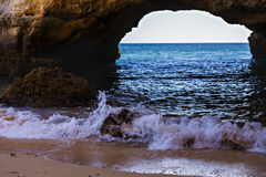 Beautiful arch of a cave. In the sun Stock Photo