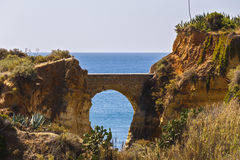 Beautiful arch of a cave. In the sun Stock Images