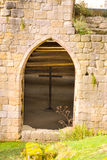 Beautiful Arch with Cross. Beautiful Arch Window with Cross taken at Fountains Abbey Stock Photos