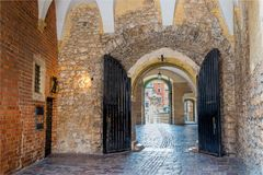 Beautiful arch of stone castle and stone pavement of the Middle. Ages Royalty Free Stock Images