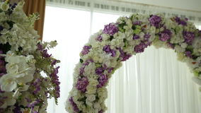 Beautiful arch for the wedding ceremony and decoration of the hall of flowers stock video