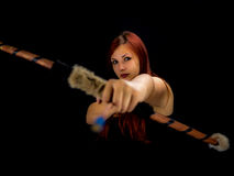 Beautiful archery woman aiming, black background Stock Images