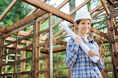 Beautiful Architect Holding Blueprint In Wooden Royalty Free Stock Image