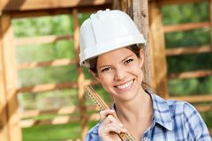 Beautiful Architect Holding Measuring Tape At Site Stock Photos