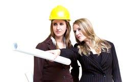 Beautiful architect women. Holding a helmet Stock Photography