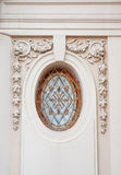 Beautiful architectural circle with stucco bas-relief Stock Photography
