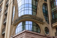 Beautiful architectural structure with large panoramic windows and balconies in antique style of gray stone for use as a hotel or. Apartment royalty free stock photos