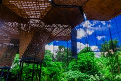 Beautiful architectural woodden structure in a botanical greenhouse in Medellin Stock Photo