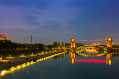 Beautiful architecture building and colorful bridge in twilight Royalty Free Stock Photo