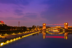 Beautiful architecture building and colorful bridge in twilight Royalty Free Stock Images