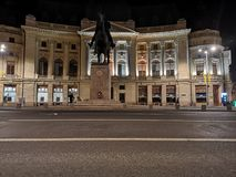 The Central University Library of Bucharest at night. A beautiful architecture: The Central University Library of Bucharest and Carol I statue royalty free stock photos
