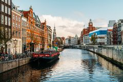 Beautiful Architecture Of Dutch Houses and Houseboats On Amsterdam Canal In Autumn. AMSTERDAM, NETHERLANDS - NOVEMBER 13, 2017: Beautiful Architecture Of Dutch Stock Image