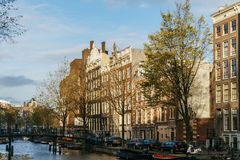 Beautiful Architecture Of Dutch Houses and Houseboats On Amsterdam Canal In Autumn. AMSTERDAM, NETHERLANDS - NOVEMBER 13, 2017: Beautiful Architecture Of Dutch Stock Photo
