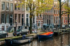 Beautiful Architecture Of Dutch Houses and Houseboats On Amsterdam Canal In Autumn. AMSTERDAM, NETHERLANDS - NOVEMBER 13, 2017: Beautiful Architecture Of Dutch Royalty Free Stock Image
