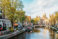 Beautiful Architecture Of Dutch Houses and Houseboats On Amsterdam Canal In Autumn Stock Photo