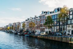 Beautiful Architecture Of Dutch Houses and Houseboats On Amsterdam Canal In Autumn. AMSTERDAM, NETHERLANDS - NOVEMBER 13, 2017: Beautiful Architecture Of Dutch Royalty Free Stock Images