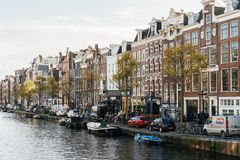 Beautiful Architecture Of Dutch Houses and Houseboats On Amsterdam Canal In Autumn. AMSTERDAM, NETHERLANDS - NOVEMBER 13, 2017: Beautiful Architecture Of Dutch Royalty Free Stock Photography