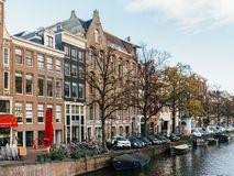 Beautiful Architecture Of Dutch Houses and Houseboats On Amsterdam Canal In Autumn. AMSTERDAM, NETHERLANDS - NOVEMBER 13, 2017: Beautiful Architecture Of Dutch Royalty Free Stock Photo
