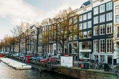 Beautiful Architecture Of Dutch Houses and Houseboats On Amsterdam Canal In Autumn. AMSTERDAM, NETHERLANDS - NOVEMBER 13, 2017: Beautiful Architecture Of Dutch Stock Images
