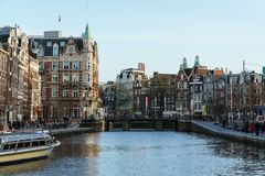 Beautiful Architecture Of Dutch Houses and Houseboats On Amsterdam Canal In Autumn. AMSTERDAM, NETHERLANDS - NOVEMBER 13, 2017: Beautiful Architecture Of Dutch Stock Photography