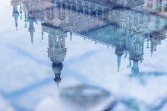 Beautiful architecture of Gran Place reflected in puddle Royalty Free Stock Image