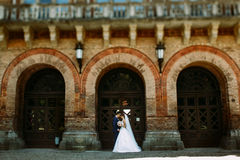 Beautiful architecture and lovely couple Royalty Free Stock Image